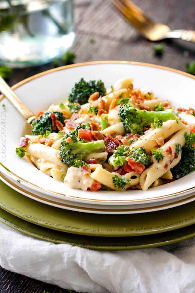 Skinny Cheesy Bacon Ranch Chicken Pasta - this easy flavorful pasta is an all time FAMILY FAVORITE with ranch chicken in a lightened up cheesy ranch sauce - with BACON, broccoli and bell peppers!