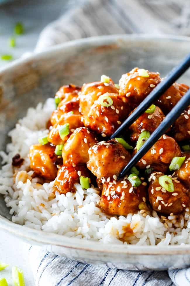 General Tso's Chicken recipe that is BAKED, not fried, smothered in an irresistible sweet and spicy, zingy sauce and about to become your favorite Chinese food fakeout takeout!