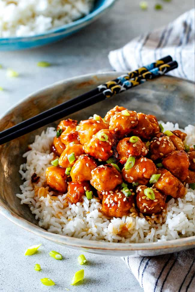 General TsoChicken recipe that is BAKED, not fried, smothered in an irresistible sweet and spicy, zingy sauce and about to become your favorite Chinese food fakeout takeout!
