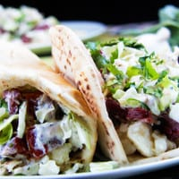 Corned Beef Brisket Pitas with Parmesan Potatoes, Cabbage and Radish Dressing