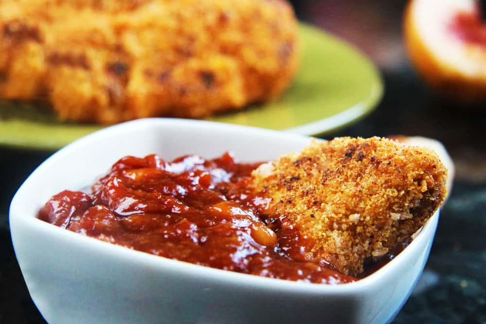 Cajun chicken tenders dunked in barbecue sauce