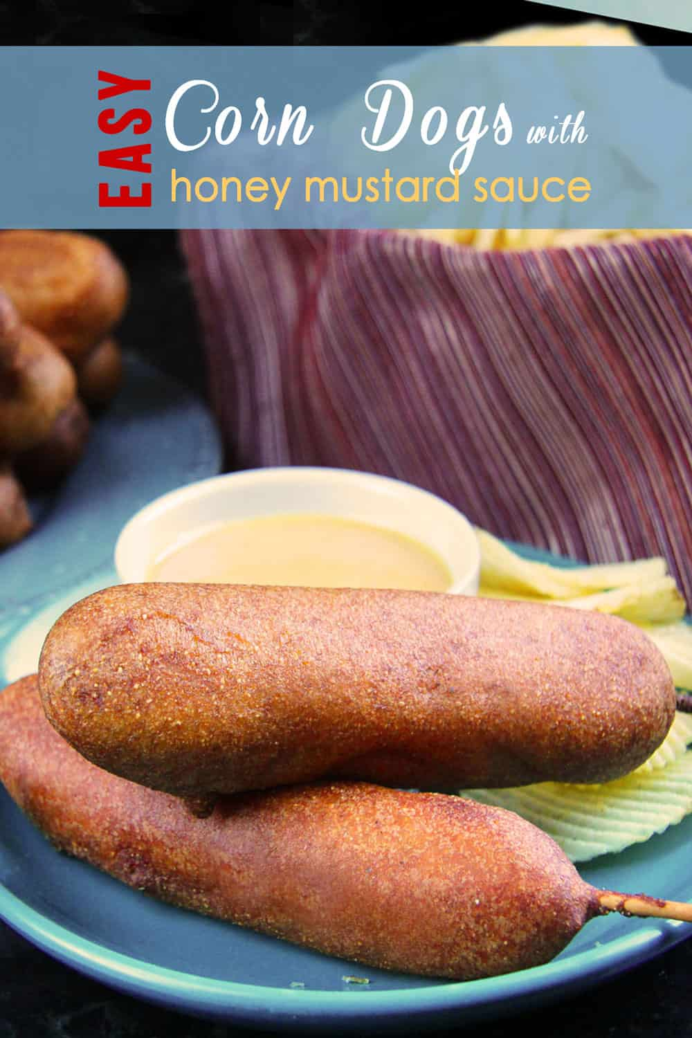two homemade corn dogs on a blue plate stacked on top each other
