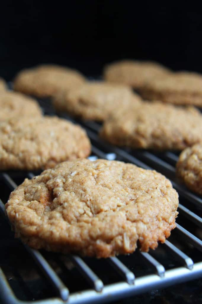 side view of homemade oatmeal cream pies cooling on a cooling rack