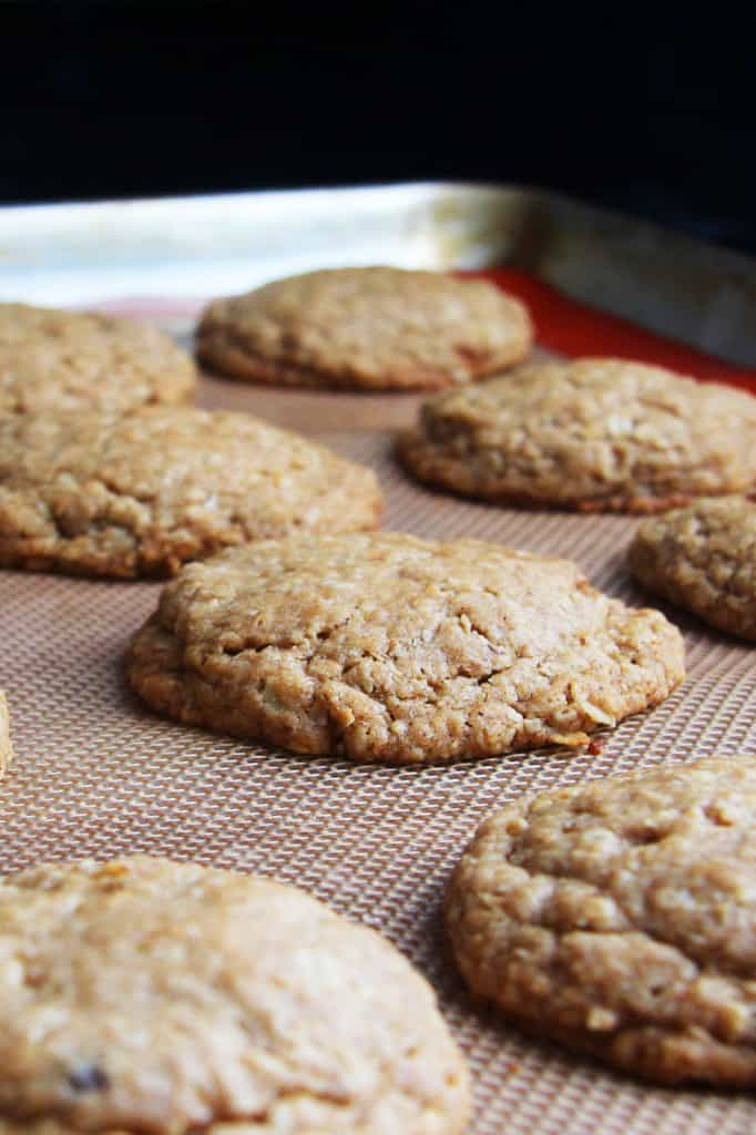 showing how to make homemade Little Debbies Oatmeal Cream Pies by baking oatmal cookies on a nonstick mat