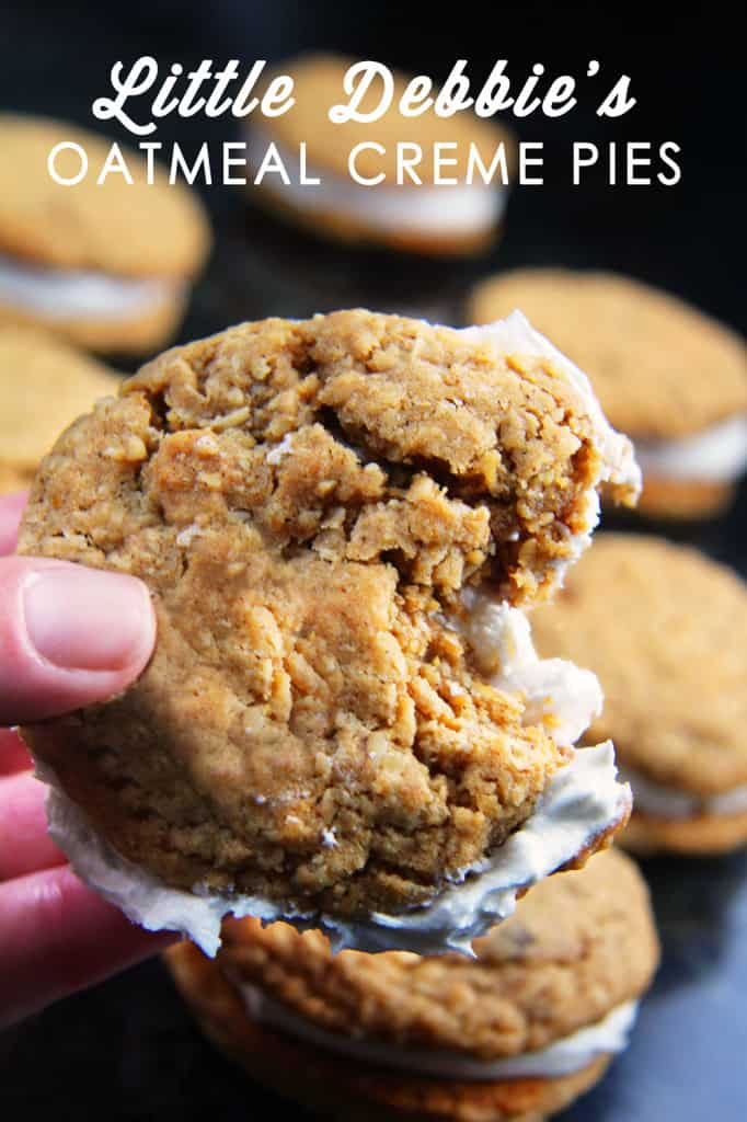 side view of homemade oatmeal cream pies with a bite taken out of one of the cookies