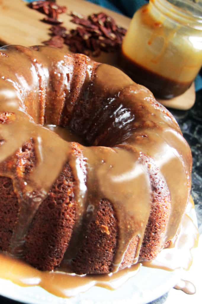 Toffee Pecan Caramel Pound Cake on a white serving plate.