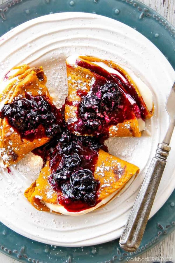 Easy Blender Brown Sugar Carrot Cake Crepes are my family's favorite crepes! Stuffed with silky sweet Cream Cheese and smothered in the most amazing Blueberry Sauce - these are addicting and so fun!!