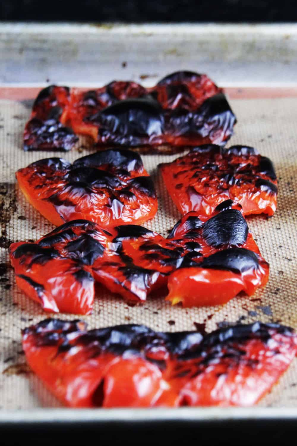showing how to make Roasted Red Pepper Pasta by roasting red peppers