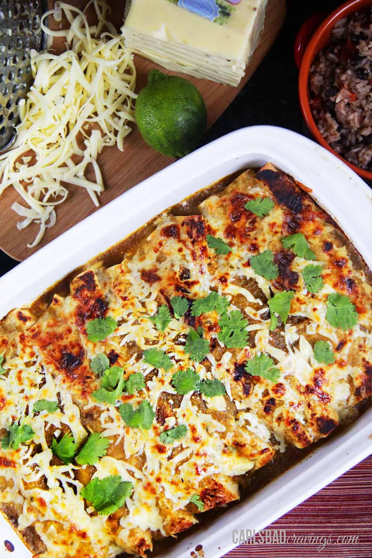 top view of salsa verde chicken enchiladas in a white baking dish