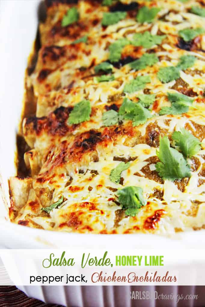 Honey Lime Salsa Verde Chicken Enchiladas in a white casserole dish.