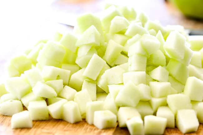 showing how to make apple syrup by chopping apples into cubes