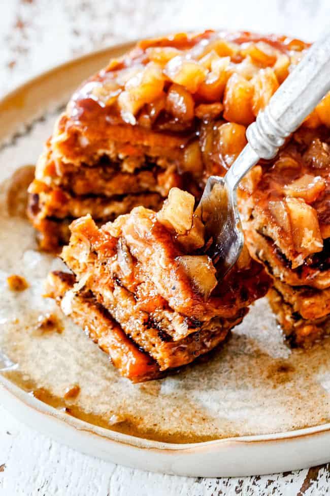 cinnamon apple syrup on a bite of sweet potato pancakes