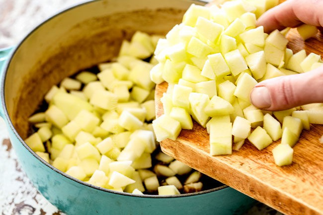 showing how to make apple syrup by adding apples to a saucepan