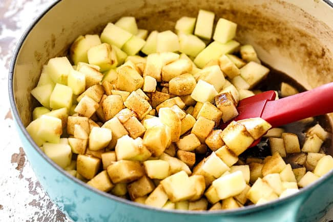 showing how to make apple syrup by stirring apples into syrup