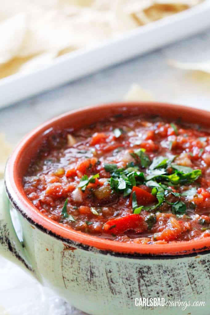 a green bowl of the best salsa recipe garnished with cilantro