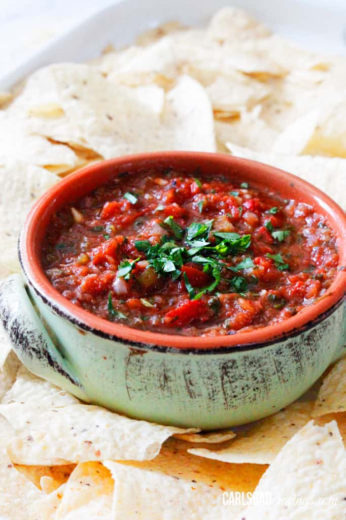 side view of a homemade salsa recipes surrounded by chips