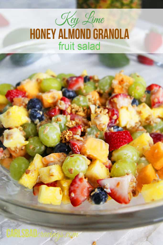 healthy creamy fruit salad with yogurt in a glass bowl