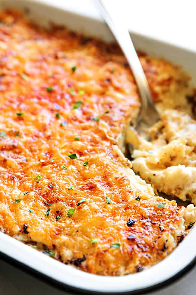 Au Gratin Potatoes with layers of potatoes with a crispy buttery cheesy crust topping