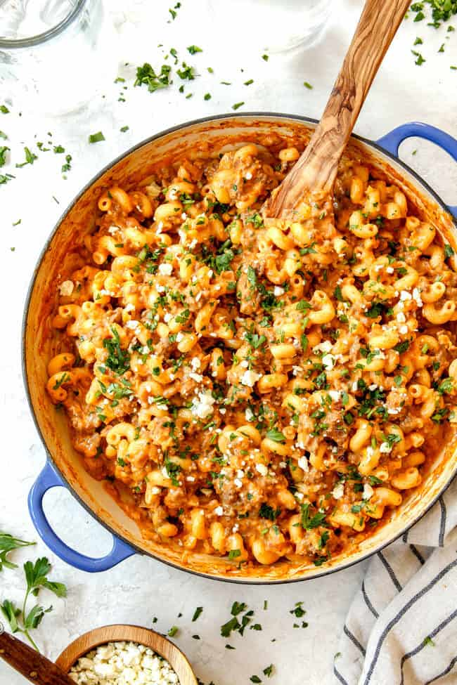top view of the best buffalo mac and cheese recipe in a skillet with blue cheese