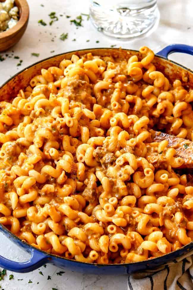a spoon stirring buffalo mac and cheese recipe