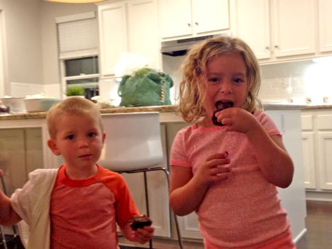 two children eating healthy Chocolate Zucchini Muffins