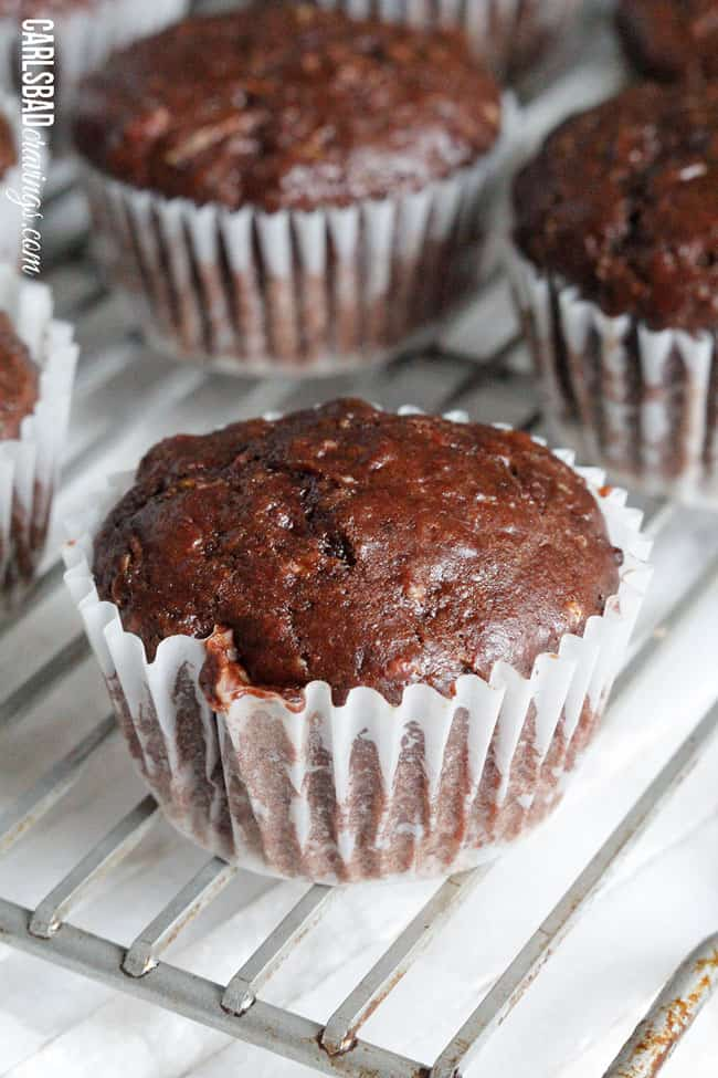 Chocolate Zucchini Muffins with DOUBLE the CHOCOLATE, ZERO added fat and a whole lot of yum!! This Chocolate Zucchini Muffins Recipe is baked with applesauce and vanilla yogurt that are crazy moist and chocolaty! You will devour these by the handfuls - becauseyou can!