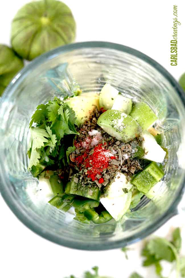 showing how to make avocado ranch dressing by adding avocado, tomatillos, cilantro, garlic, jalapeno to blender