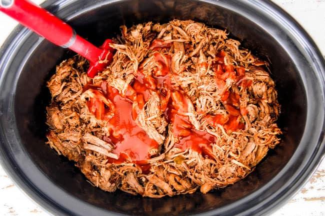 adding enchilada sauce to shredded chipotle pork in crockpot to make Cafe Rio Sweet Pulled Pork