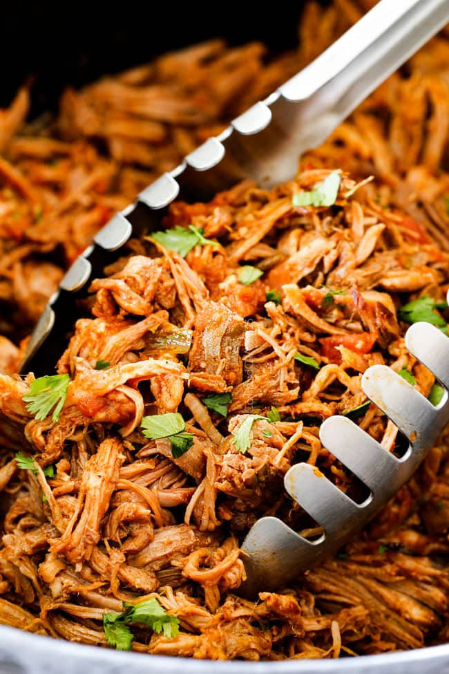 up close of tongs picking up best cafe rio sweet pulled pork