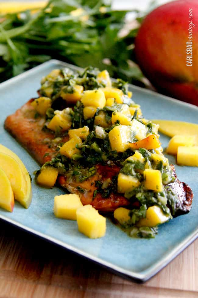 showing how to serve chimichurri sauce by adding tot salmon