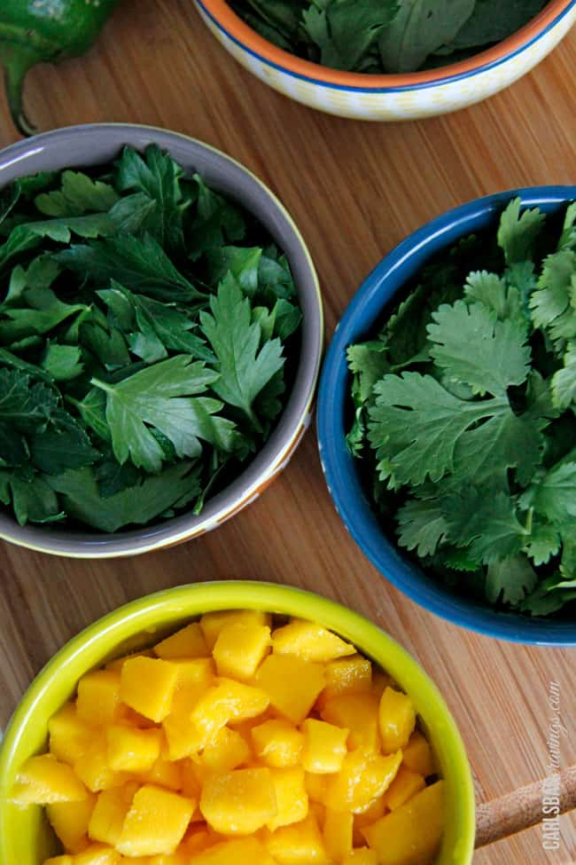 showing how to make chimichurri by lining up parsley, garlic, oregano oil