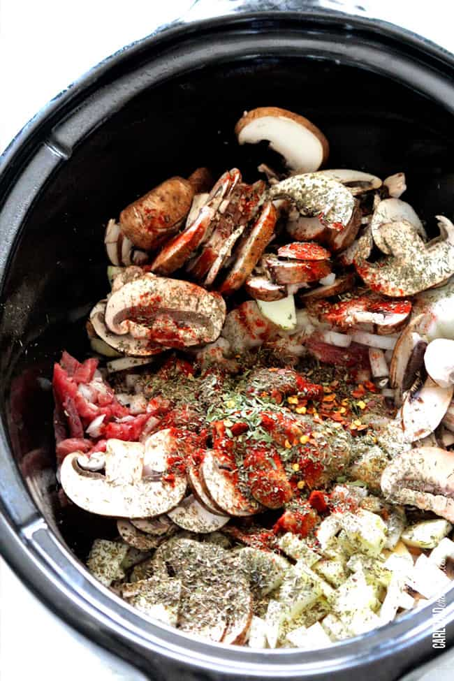 Showing how to make Beef Stroganoff Soup by adding mushrooms and vegetable in the slow cooker.
