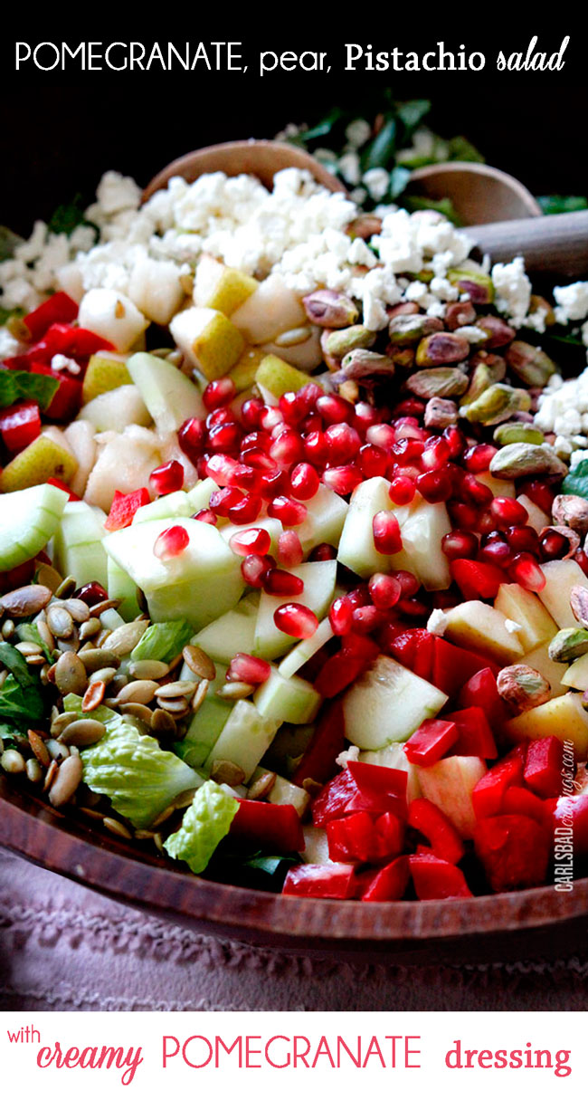 Pomegranate, Pear Pistachio Salad with Creamy Pomegranate Dressing in a wooden bowl.