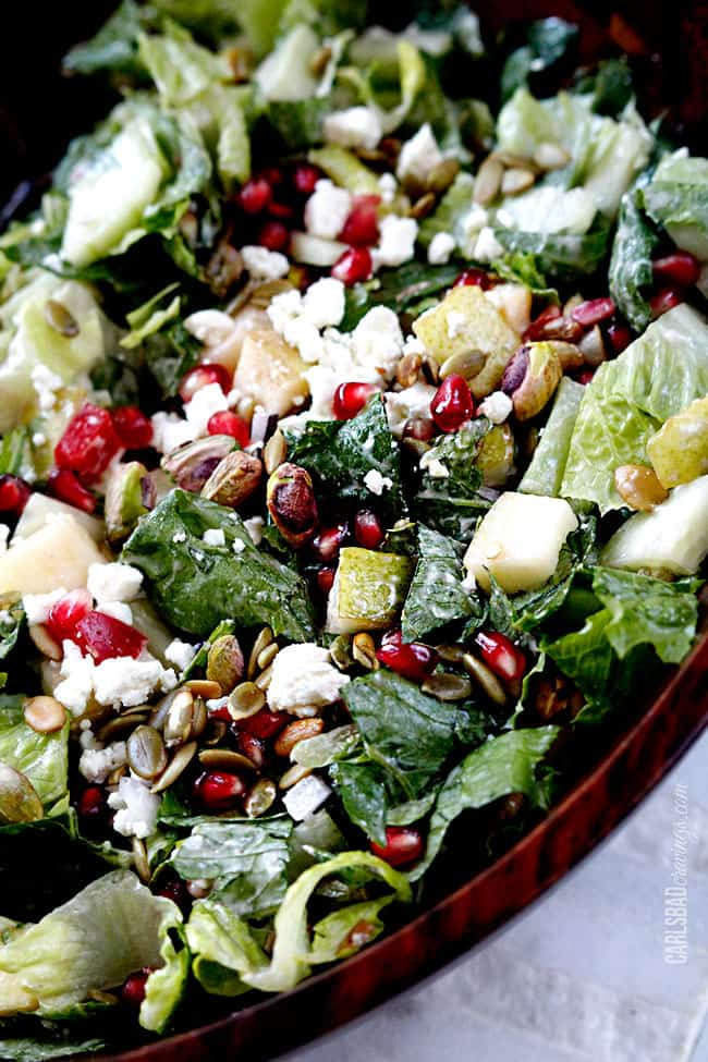 a pear salad that's been tossed with pomegranate salad dressing