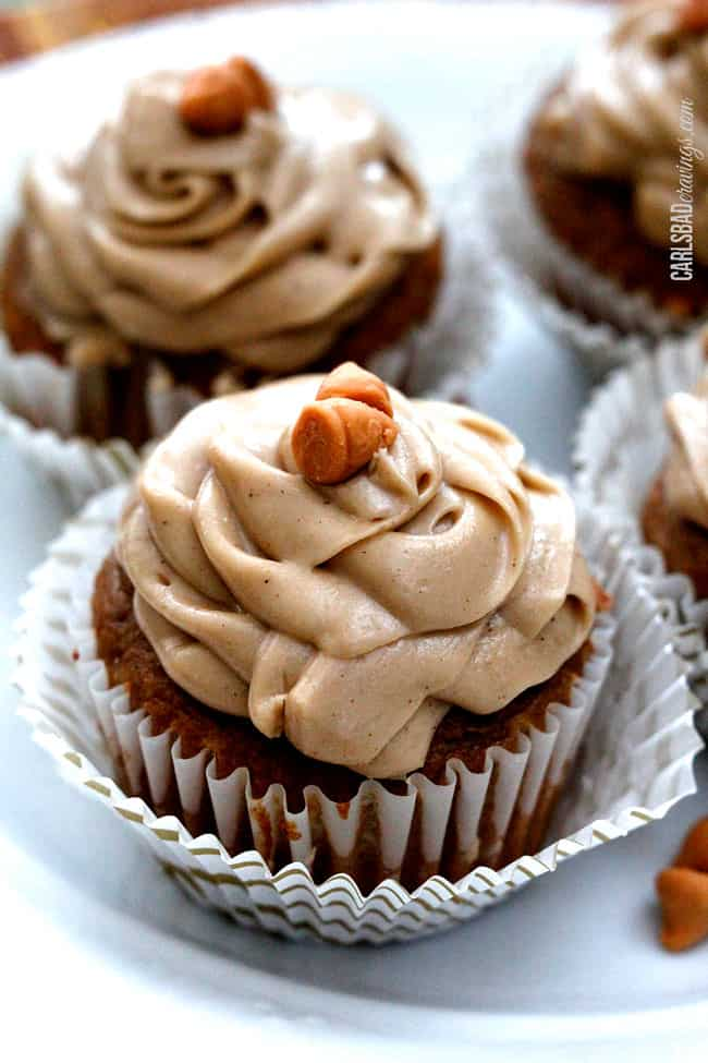 close up of four pumpkin cupcakes with cake mix in cupcake liners