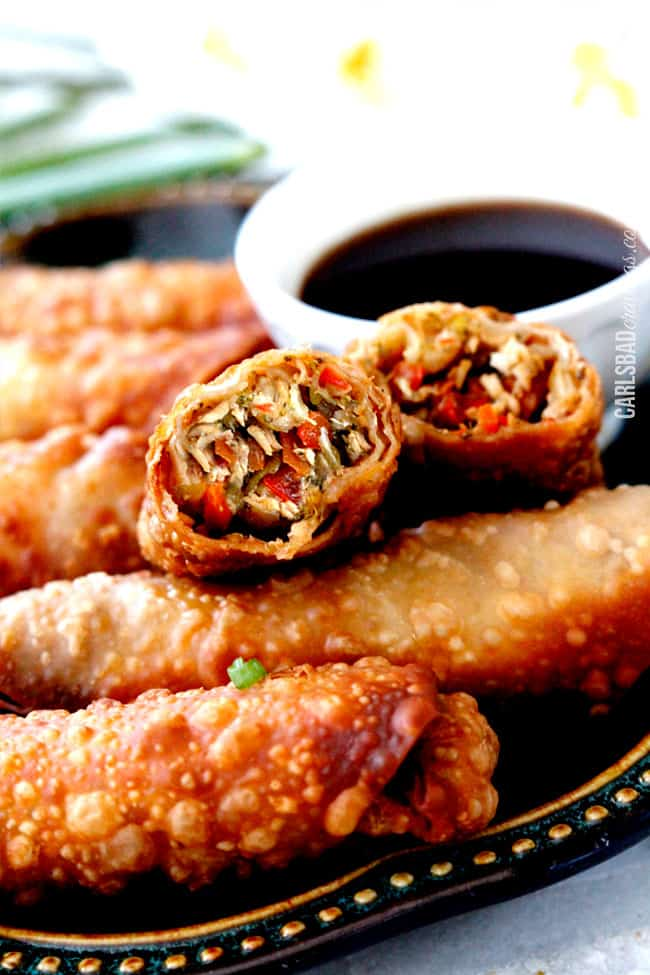 a baked chicken egg roll cut open so you can see the chicken and vegetable filling