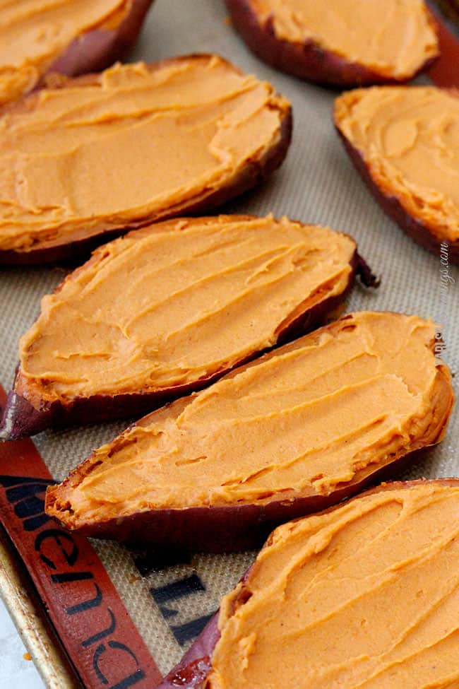 showing how to make twice baked sweet potatoes by filling sweet potatoes with filling