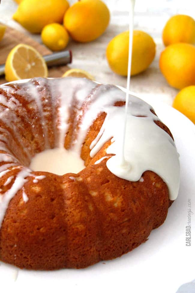 Drizzling lemon glaze on Lemon Poke Cake.