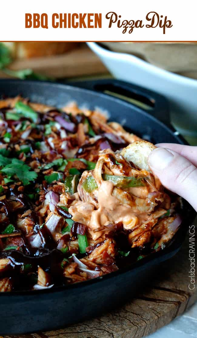 Scooping BBQ Chicken Pizza Dip out of a black serving dish.