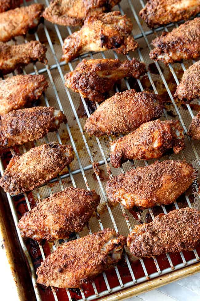 Side view showing the baked Honey Buffalo Hot Wings on a baking rack.