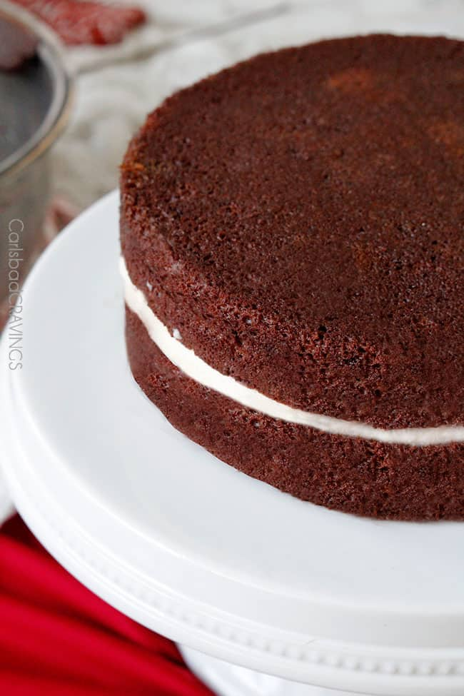 showing how to make Chocolate Peppermint Cake layering chocolate cake with peppermint filling
