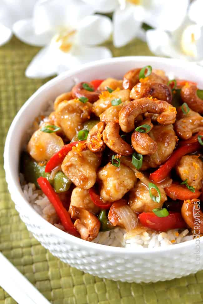 spicy cashew chicken stir fry recipe in a white bowl