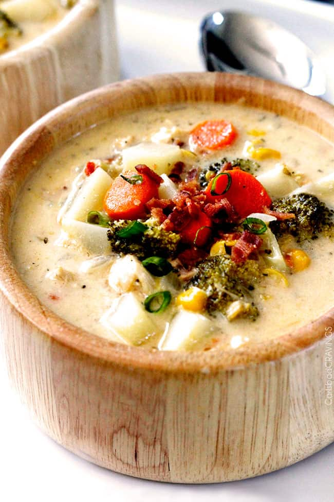 Flavor packed, EASY creamy, cheesy comforting Slow Cooker Bacon Ranch Chicken Chowder is the ultimate comfort soup packed with corn, potatoes and broccoli with NO butter or cream but SO much flavor!! #broccolicheesesoup #chowder #potatosoup