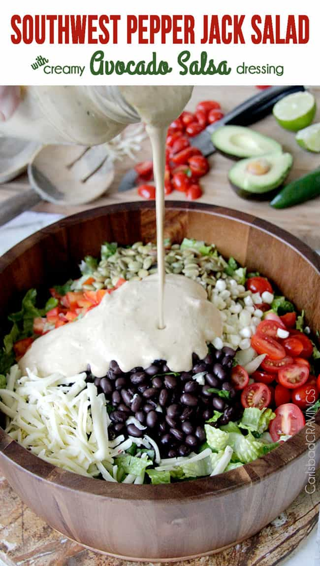 Southwest Pepper Jack Salad with Creamy Avocado Salsa Dressing in a wooden bowl.