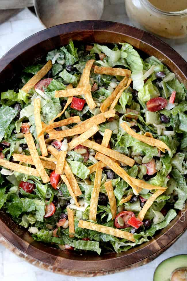 top view of Southwest Salad tossed with Southwest Dressing and garnished with tortilla chips