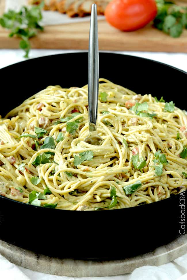 healthy, creamy, easy Avocado Pasta in a skillet with a fork