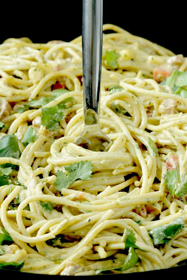 up close of a fork in easy Avocado Pasta Sauce