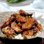 Baked General Tso's Sticky Wings over rice top view side view.
