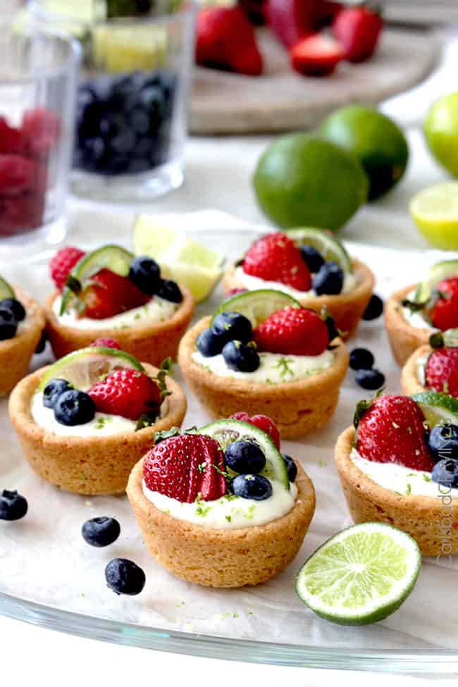 Berry Lemon Cheesecake Cookie Cups - a lemon cookie cup is filled with ...