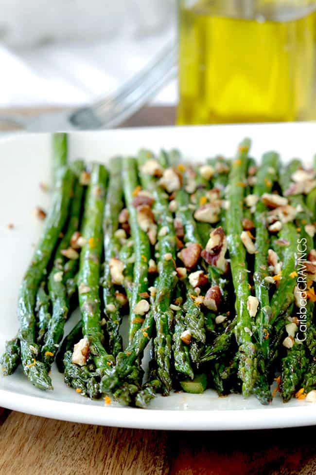 Roasted balsamic Asparagus on white plate